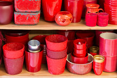 Red flowerpots in the florist store Royalty Free Stock Photography