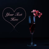 Red flowers, champagne, and heart Stock Photos