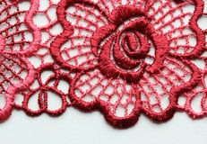 Red flowers lace material texture macro shot Stock Images