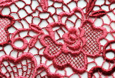 Red flowers lace material texture macro shot Stock Photo