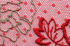 Red flowers lace material texture macro shot Stock Photography