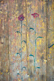 Red flowers painted on old boards Stock Images