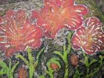 Flowers painted on old stone Stock Photography