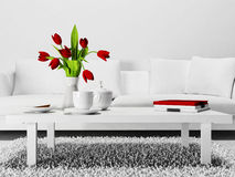 Red flowers on the  table Royalty Free Stock Images