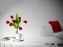 Red flowers on the  table Royalty Free Stock Photography
