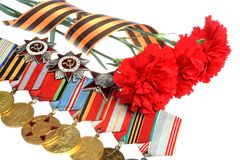 Red Flowers Tied With Saint George Ribbon, Medals, Orders Royalty Free Stock Photography