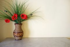 Red flowers in vase. Vase with flowers on table Royalty Free Stock Photography