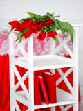 Red flowers on a white stand Royalty Free Stock Photos