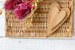 Red flowers and wooden hearts. For Valentine\'s day Stock Photography