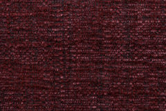 Red fluffy background of soft, fleecy cloth. Texture of textile closeup Royalty Free Stock Photo