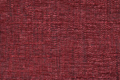 Red fluffy background of soft, fleecy cloth. Texture of textile closeup Stock Photos
