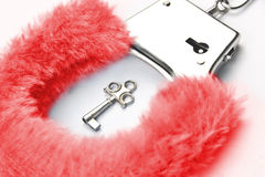 Red fluffy handcuffs Stock Image