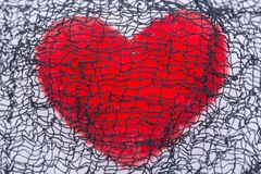 Red fluffy heart and creepy cotton web cloth.