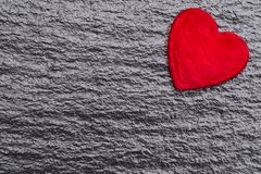 Red fluffy heart over black slate background. With copy space Royalty Free Stock Photos