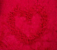 Red fluffy texture with heart Royalty Free Stock Photos
