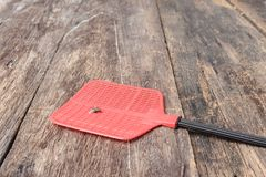 Red fly swatter. Single flyswatter made of plastic and unfailing Stock Photography