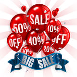 Red flying party balloons with text SALE and Stock Image
