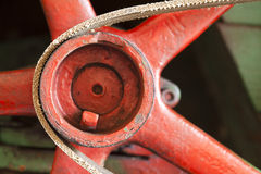 Red flywheel with belt Royalty Free Stock Photo