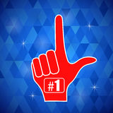 Red  Foam Finger. Isolated on Blue Polygonal Background Royalty Free Stock Images