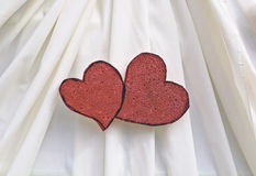 Red foam  heart decorated on beige cloth Stock Photos
