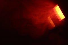 Red fog light. Red concert light, fog, black background Royalty Free Stock Photos