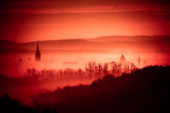Red foggy dawn in town of Krizevci Stock Images