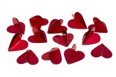 Red foil heart shaped confetti Stock Photos