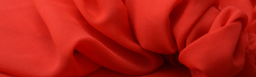 Red folded fabric background. Stock Photos