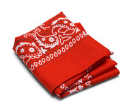 Red Folded Hankerchief. Red Pasiley Bandana Isolated on a White Background Royalty Free Stock Photo