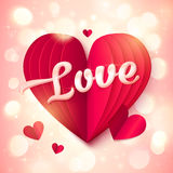 Red folded paper heart with pink 3d Love sign at bokeh light background Royalty Free Stock Photo