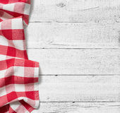 Red folded tablecloth over white wooden table. Red tablecloth over white wooden table Royalty Free Stock Photo
