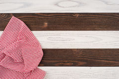 Red folded tablecloth over wooden table. Top view Royalty Free Stock Photography