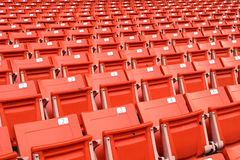 Red folding chairs lined on the stadium sport Stock Photo