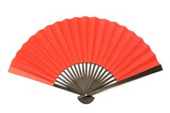 A red folding hand fan made of wood and paper royalty free stock photo