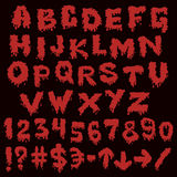 Red font smudges. alphabet splashing Royalty Free Stock Image