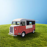 Red food truck on the green field. Red retro fast food truck on green field with blue sky, template with copy space royalty free stock images