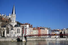 Red footbridge and church in Lyon city Royalty Free Stock Photo