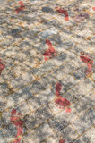 Red Footprints on Sidewalk Stock Photography