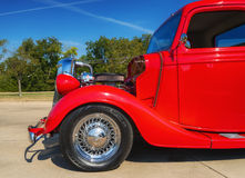 Red 1935 Ford pickup truck. A red 1935 Ford pickup truck classic car. Closeup of front side Stock Image
