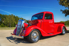 Red 1935 Ford pickup truck. A red 1935 Ford pickup truck classic car. Front side view Stock Photos