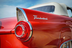 Red 1956 Ford Thunderbird Convertible Classic Car. Tail fin and taillight details of a red 1956 Ford Thunderbird Convertible classic car Stock Image