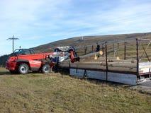 Forklift unload logs. The red forklift unload logs stock images