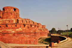 Red Fort Entrance and Surrounding Moat. The Fort at Agra Akbar is among the many Mughal Architectural highlights to be seen in Agra. The richness and artistry of Stock Photo