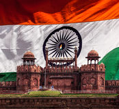 Red Fort (Lal Qila) against Indian national flag. Delhi, India Stock Photo