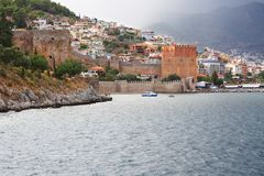 Red fortress. Colourful panorama of an ancient  red fortress in the Turkish city of Alanii on the bank of Mediterranean sea Stock Photos