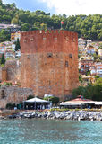 Red fortress. Colourful photo of an ancient  red fortress in the Turkish city of Alanii on the bank of Mediterranean sea Royalty Free Stock Photography