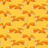 Red fox seamless pattern. Seamless background with running cartoon red foxes, vector pattern Royalty Free Stock Photography