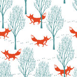 Red foxes in a winter forest background Stock Photo