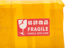 A red  Fragile - Handle with Care sticker Stock Photography