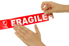 Red fragile tape. Hand stick red fragile tape Stock Images